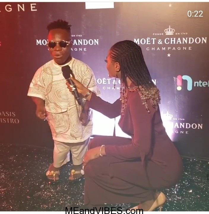 Presenter Squats to interview Ghanaian Billionaire, Shatta Bandle (Photo)